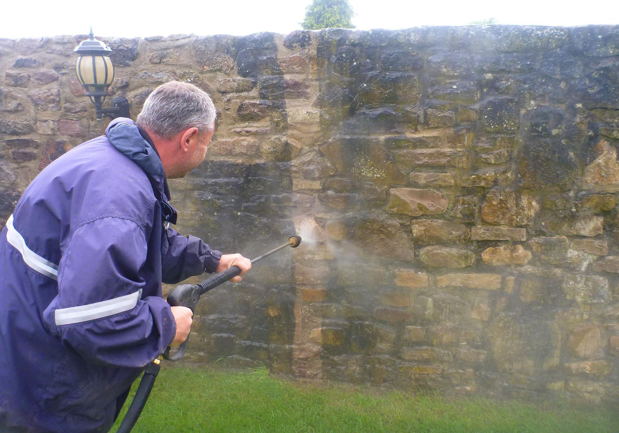 An image of a Ultimate Cleaning Solutions team member cleaning a wall